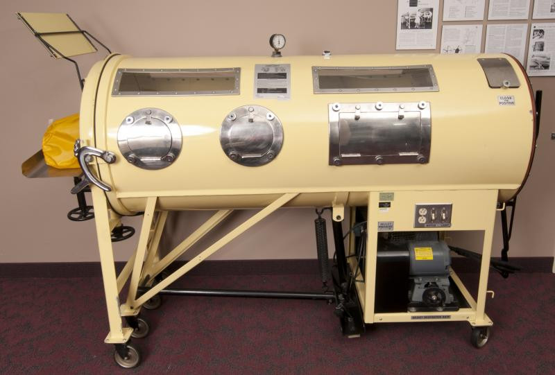 photograph of a yellow 1952 Iron Lung