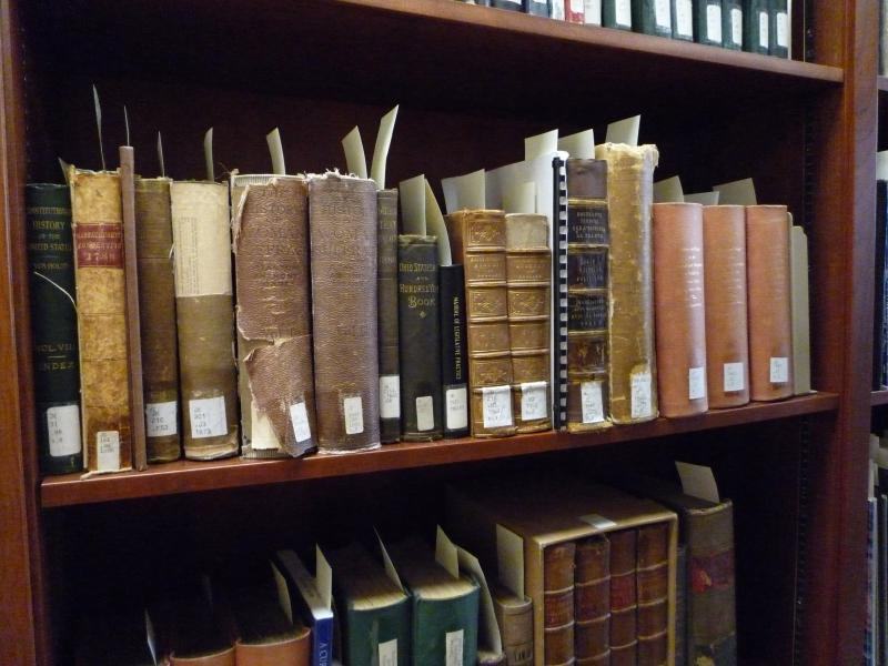 photograph of old books on a bookshelf