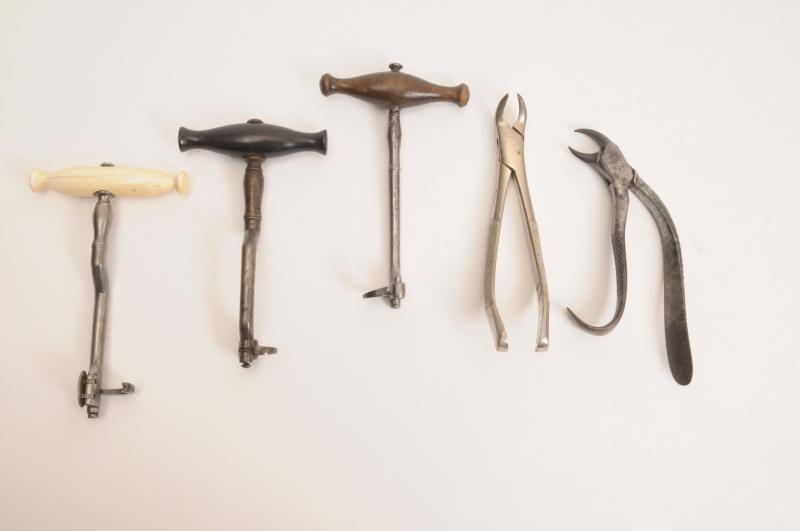 photograph of 19th century dentist's tools such as a toothkey and forceps for extracting teeth
